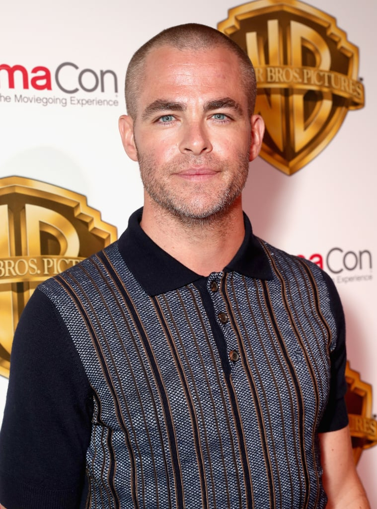 Chris Pine attended CinemaCon in Las Vegas on Wednesday to help promote the upcoming Wonder Woman film, in which he stars as Gal Gadot's onscreen love interest, Steve Trevor. This would have been a totally normal appearance if not for the fact that Chris showed up with a completely shaved head and face, meaning we no longer have his slicked-back 'do and salt and pepper beard to swoon over. He's definitely still Crush Pine in my eyes (that's just a little nickname I've given him), but as a fan of facial hair, I'm admittedly bummed. Thoughts on Chris's new look?