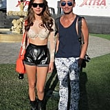 We don't know which we like better — her leather shorts or his awesome printed pants.