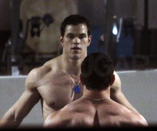 Slide Photo of Shirtless Kellan Lutz Working out in Front of The Mirror