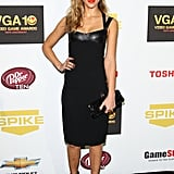 Jessica Alba showed off a smoking hot way to incorporate a bit of leather for a night out. She wore a sleek knee-length tank dress by Narciso Rodriguez, and pumped up the volume with a pair of Giuseppe Zanotti cage heels and a sweep of bright red lipstick.