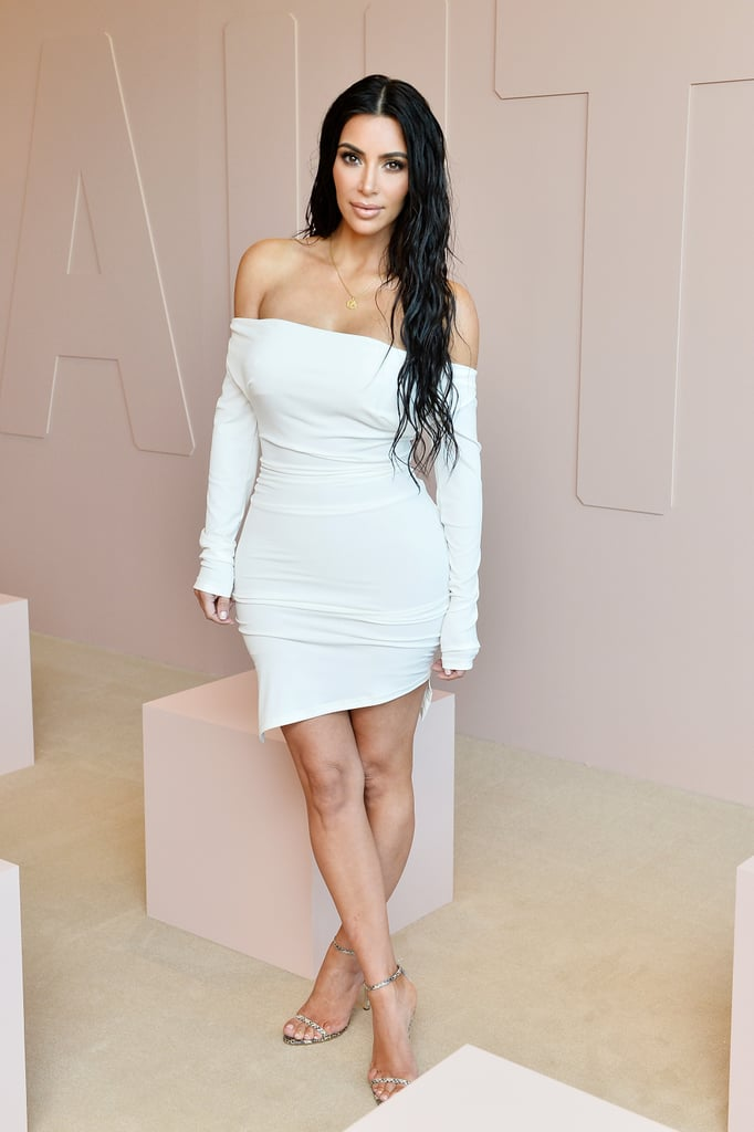 Kim wore a Vivienne Westwood off-the-shoulder dress to her KKW Beauty launch.