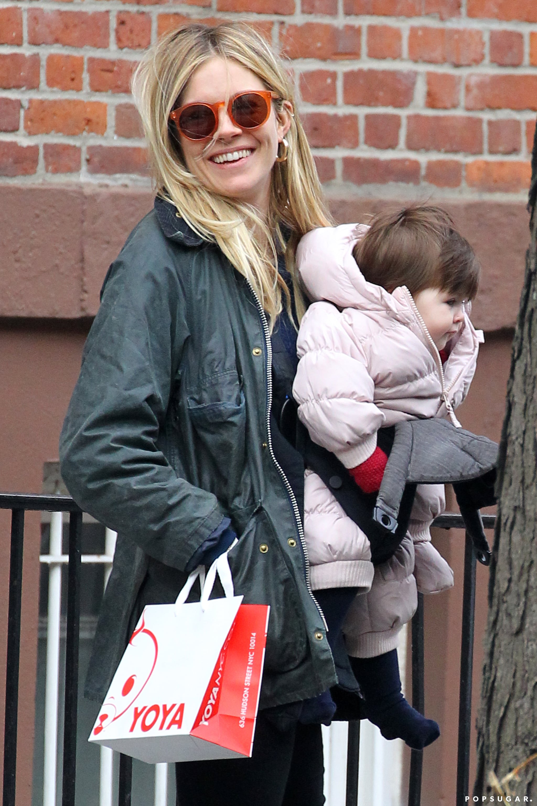 Sienna Miller carried Marlowe for a day of shopping in NYC.