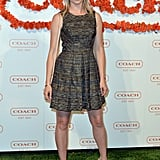 Amy Smart went with a graphic-print skater dress and strappy nude heels at the Coach benefit.