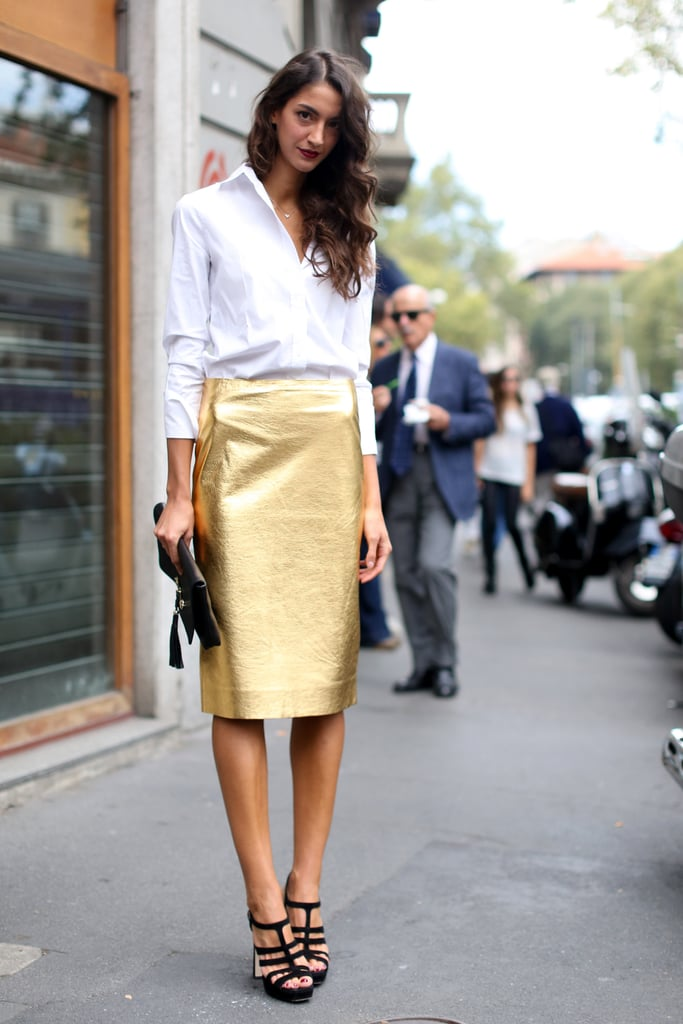 All that glitters in this ensemble? A perfect splash of gold on her polished pencil skirt.