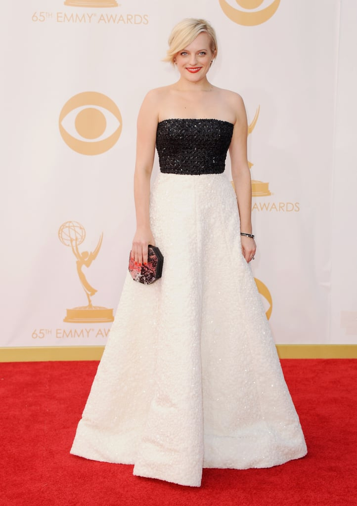 She wore an Andrew Gn dress, Casadei shoes, Neil Lane jewels, and a Rauwolf clutch to the 2013 Emmys.