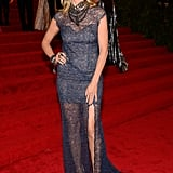 Heidi Klum showed some leg in a classic Escada gown.