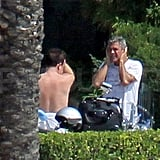 George Clooney chatted with Bono in Lake Como.