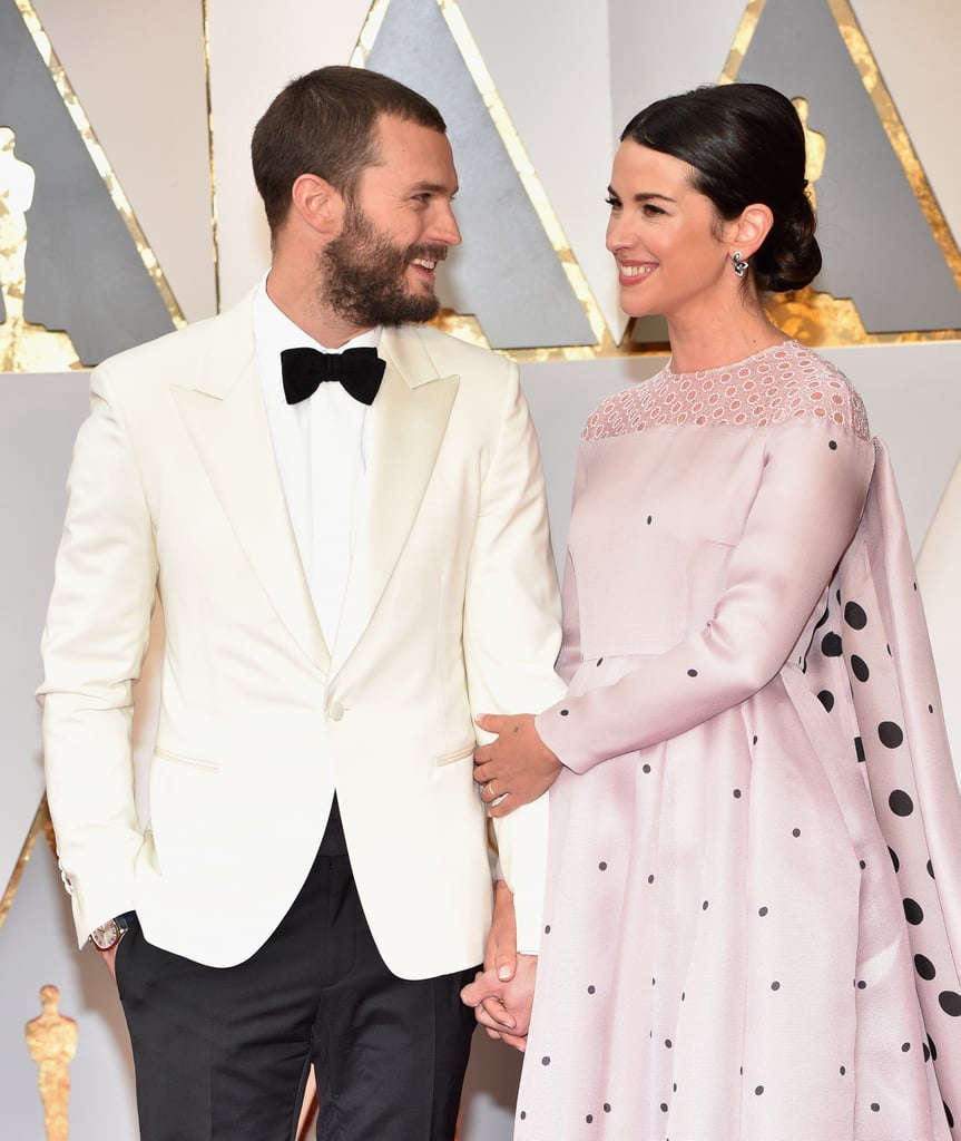 Of all the adorable couples who showed up to the Oscars on Sunday night, Jamie Dornan and Amelia Warner may have been one of the cutest. The sweet pair have made a habit of turning up to red carpet events looking head over heels for each other ever since they tied the knot in 2013. The Fifty Shades Darker actor looked sharp in black and white, while Amelia stunned in a gorgeous, fairy-tale-princess-worthy pink gown.