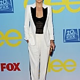 Kate Hudson put a sexier slant on her white and black tuxedo suit with the help of a sheer lace camisole underneath.
