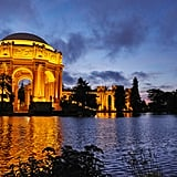 Walk around the Palace of Fine Arts at night.