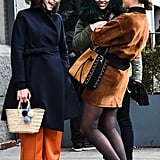 Style It With a Belted Trench Coat, Orange Trousers, and White Sneakers