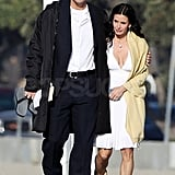 Courteney Cox kept warm next to her handsome costar Josh Hopkins.