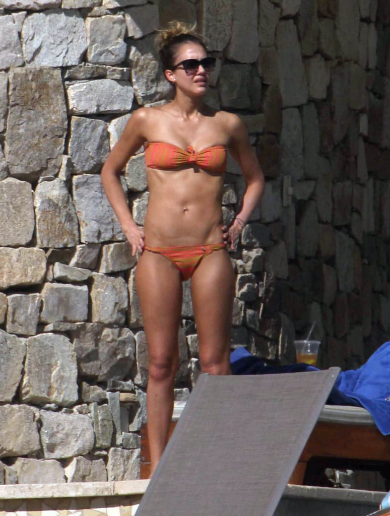 Jessica Alba sported a bright orange bikini while soaking up the sun in Cabo today. She was joined by her daughters, Honor and Haven, and a group of friends to lounge poolside at their resort. Jessica and her family have been in Mexico for the last few days relaxing and celebrating the New Year. She and husband Cash Warren rang in 2013 with pals including Kelly Sawyer and a whole host of other famous faces. George Clooney, Michael Phelps, and Jennifer Aniston were all also south of the border for the big night. The end-of-year trip is becoming tradition for the Alba-Warrens after they also welcomed 2012 there. During that getaway, Jessica sported a hot-pink two-piece and showed off the beach-ready physique that landed her a spot among our sexiest bikini moments of the year.