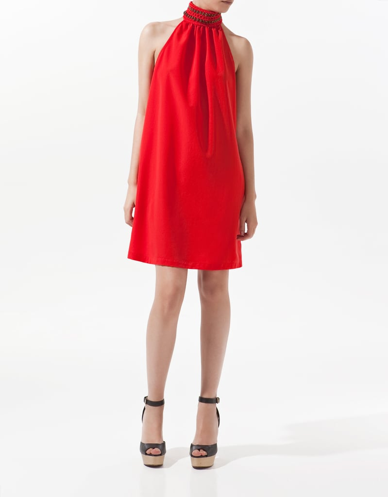 If you don't already own a stunning red dress, now is the time to add one to your party wardrobe.  Zara Red Braided Halter Neck Dress ($50, originally $80)