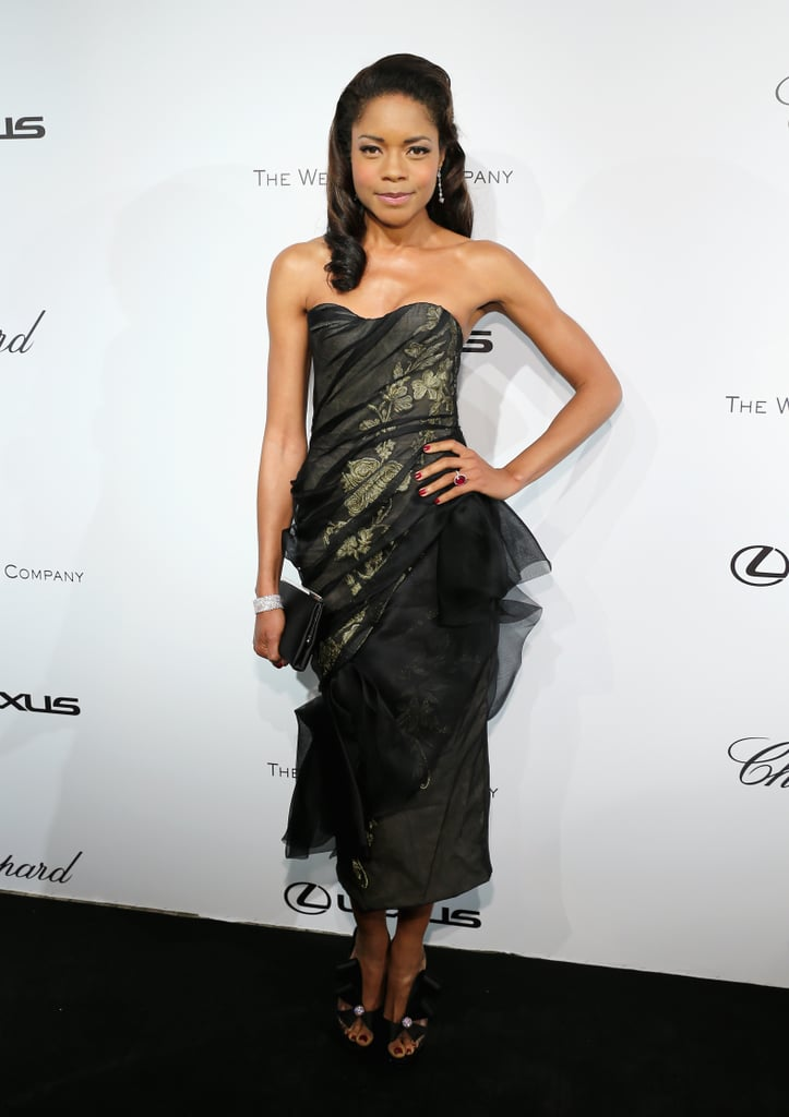 Naomie Harris brought dark glamour to The Weinstein Company party in Cannes in a sheer strapless Marchesa dress and bow sandals.