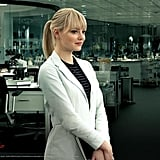 Gwen sporting a white coat with a striped top.