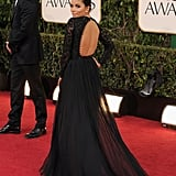 Eva Longoria stunned in a revealing, floor-length black lace gown.
