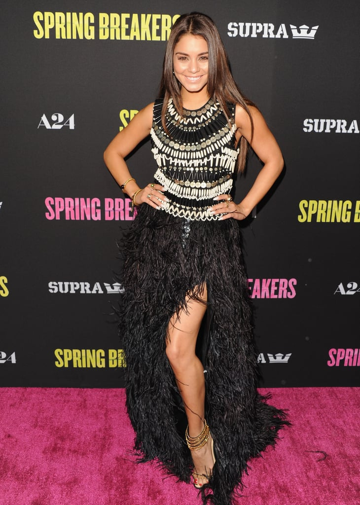 Vanessa Hudgens pulled out all the glamorous stops in this embellished, ostrich-feathered, and sexy thigh-high-slit-Naeem Khan gown at the Spring Breakers LA premiere. She completed her ensemble with Neil Lane jewels and gold strappy sandals.