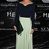 Model Arizona Muse's mint-green maxi skirt played beautifully against her black top and studded Valentino clutch.