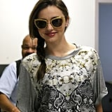 Miranda Kerr had her hair in a braid as she landed at LAX.