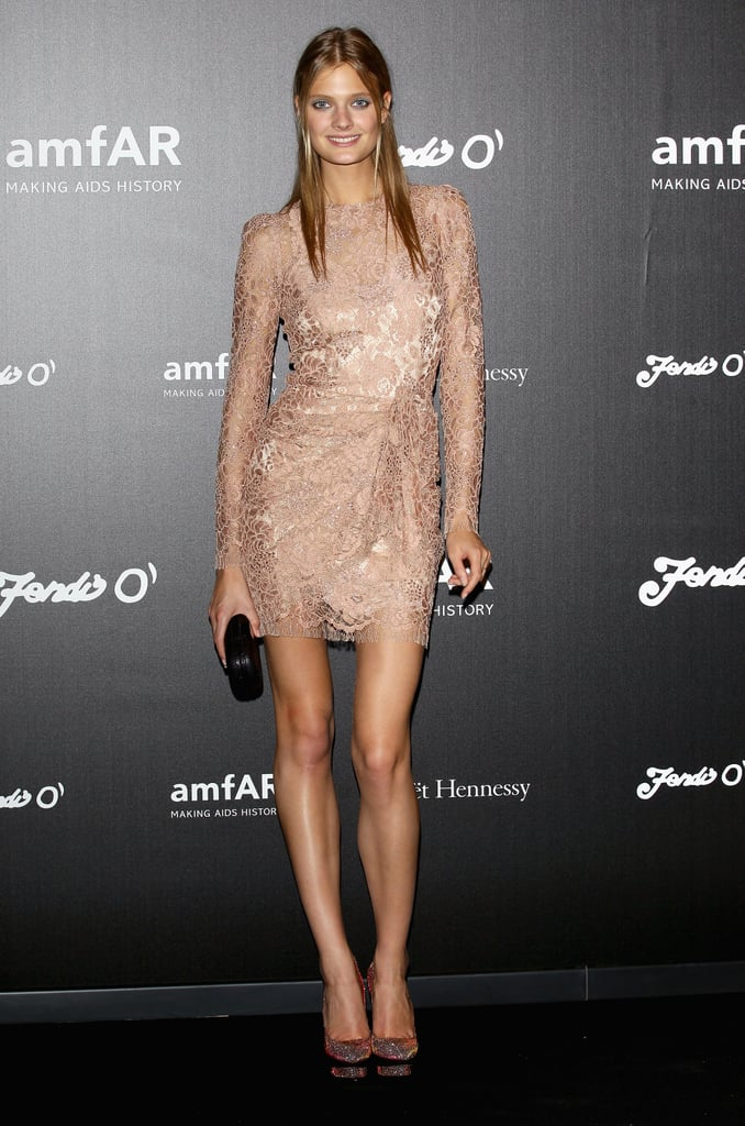Constance Jablonski showed off her supermodel pins in a lace minidress for amfAR's party.