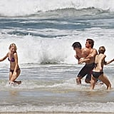Naomi Watts and Robin Wright wore bikinis and played on the beach for The Grandmothers with shirtless Xavier Samuel and James Frecheville.