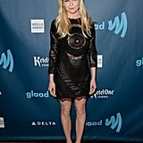 Kirsten Dunst hit the red carpet in a long-sleeved, suede, and leather Emilio Pucci number, which she accessorized with a sweet headband and a pair of classic black pumps.
