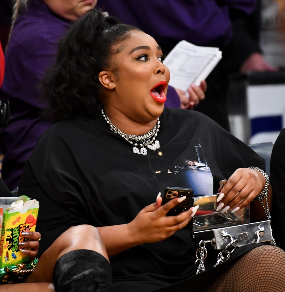 "Fresh off her performance at KIIS FM's Jingle Ball, Lizzo hit up the Los Angeles Lakers vs. Minnesota Timberwolves game in LA on Sunday night. The 31-year-old singer clearly felt good as hell as she sat courtside and cheered on Timberwolves player Karl-Anthony Towns. ""I'm personally cheering for No. 32,"" she told a reporter. ""That's my baby!"" At one point, Lizzo even got up to twerk when her hit ""Juice"" began playing. As the cheerleaders danced to the song, Lizzo showed off her butt as she got down in fishnet tights and a black thong on the Jumbotron. Classic Lizzo!  Following the game, the Timberwolves tried to play matchmaker when they posted the clip of Lizzo talking about Karl on their Twitter account. ""New man on the Minnesota Timberwolves,"" they wrote, tagging Lizzo and Karl. No word on whether Karl has reached out to Lizzo yet, but in case you were wondering, she is single.      Related:                                                                                                           Blame It on Her Juice: 100+ of Lizzo's Sexiest Photos"