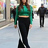 Ashley Graham gives us inspiration for the sporty-chic play on the trend with track-style pants paired with heels.