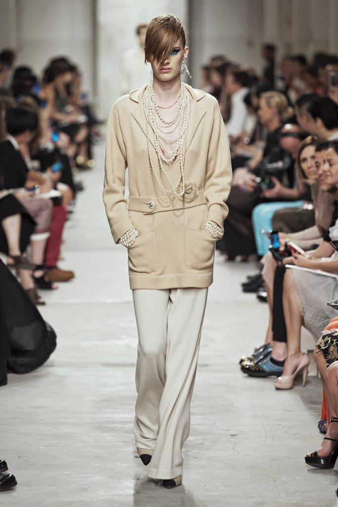 An oversize cardigan feels luxurious, not lazy, with ropes of pearls. Source: Chanel