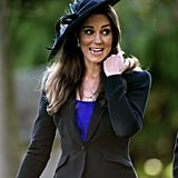 The then-girlfriend of Prince William attended a wedding in a feather-trimmed wide-brim hat in 2010.