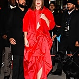 She Wore a Fuzzy Red Coat Over Her Look
