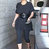 Kim Wearing an Oversize Black Tee and a Leather Belt