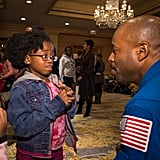 NASA Astronaut, Leland Melvin, talks to a young girl about, what we're guessing is the awesomeness of space and STEM education. Just a guess.  Source: Flickr User NASA HQ