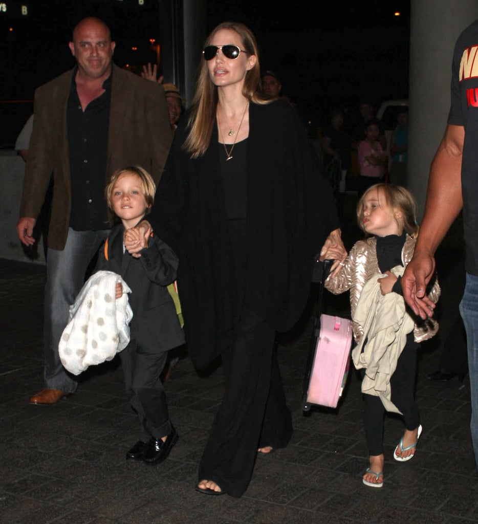 Angelina Jolie held onto Knox and Vivienne's hands.