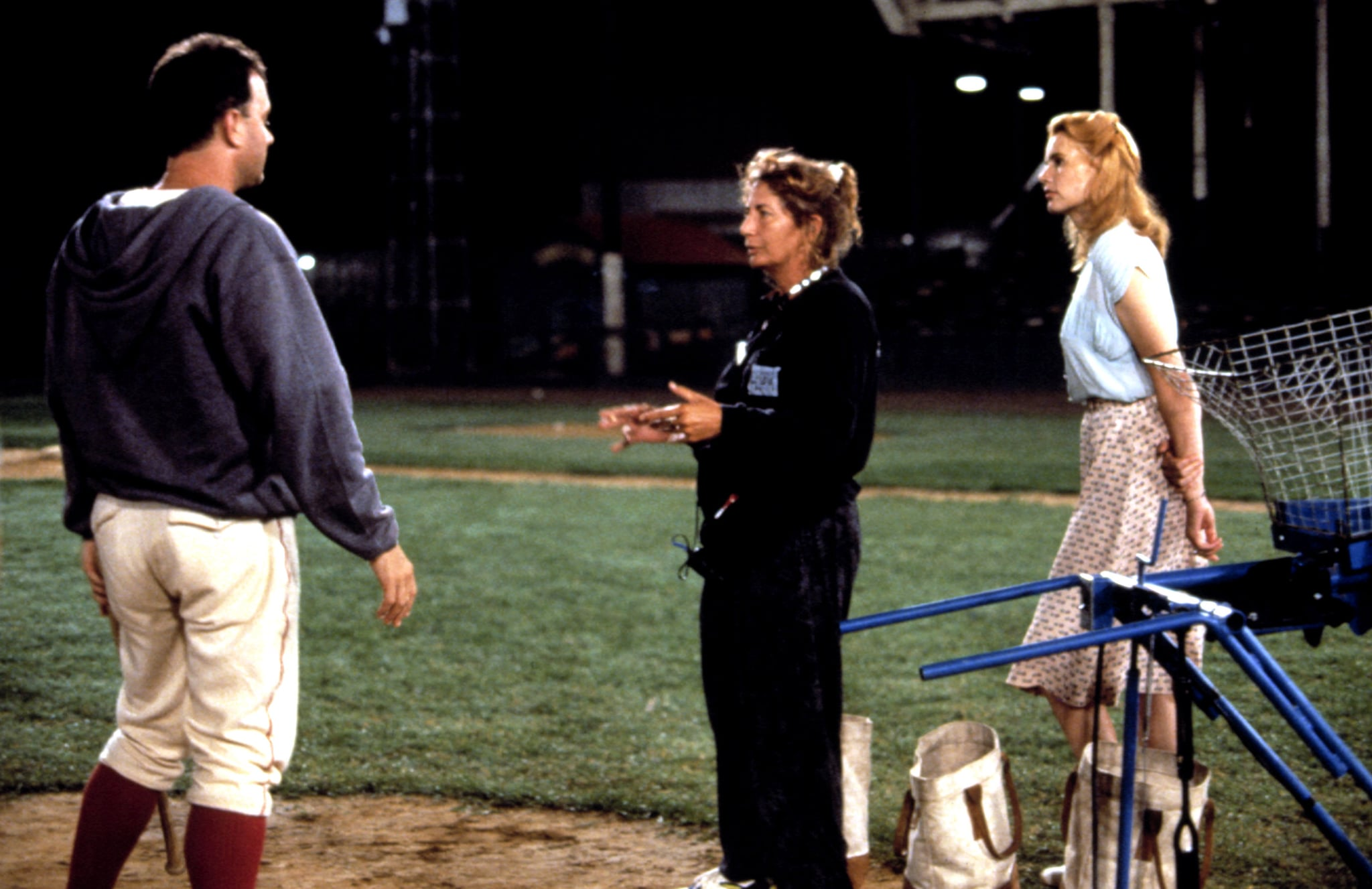 A LEAGUE OF THEIR OWN, Tom Hanks, Penny Marshall, Geena Davis on set, 1992, (c)Columbia Pictures/courtesy Everett Collection