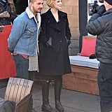Evan Rachel Wood conducted an interview at Sundance looking sleek in an all-black ensemble, including a swing coat and black knee-high riding boots.