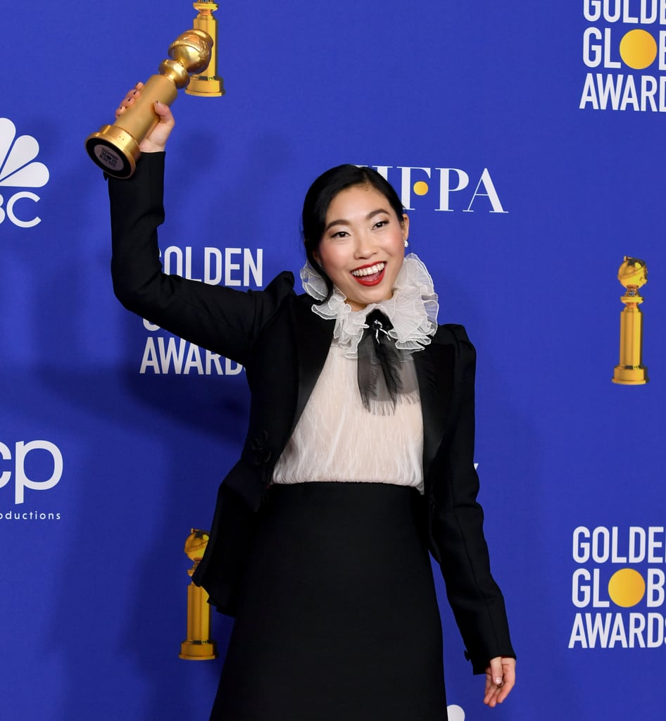 "Congratulations are in order for Awkwafina! The 31-year-old actress made Golden Globe history by being the first performer of Asian descent to win a Golden Globe Award in a lead actress film category. While taking the stage to accept her award for best actress in a movie, musical or comedy, Awkwafina gave a few sweet shout-outs to her loved ones. ""I'd like to dedicate this to my dad, Wally. I told you I'd get a job, dad,"" she joked. ""And to my grandma, my best friend, the woman who raised me, and to my mother, Tia, who I always hope was watching from somewhere above, and I hope that she's watching now.""  The Farewell centers around Awkwafina's character, Billi Wang, who visits her dying grandmother, Nai Nai (Zhao Shuzhen), in China. Unbeknownst to Nai Nai, she's been diagnosed lung cancer and only has a short amount of time left to live. The theme of love and familial relationships certainly struck a chord with Awkwafina. Watch her heartfelt acceptance speech ahead!"