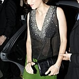 Marion Cotillard carried a simple black clutch.
