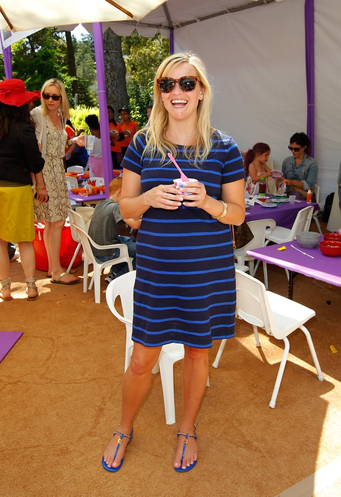 Donning a striped Gap shift and cobalt Tory Burch sandals, Reese proved she's not all about labels with her Summer look.