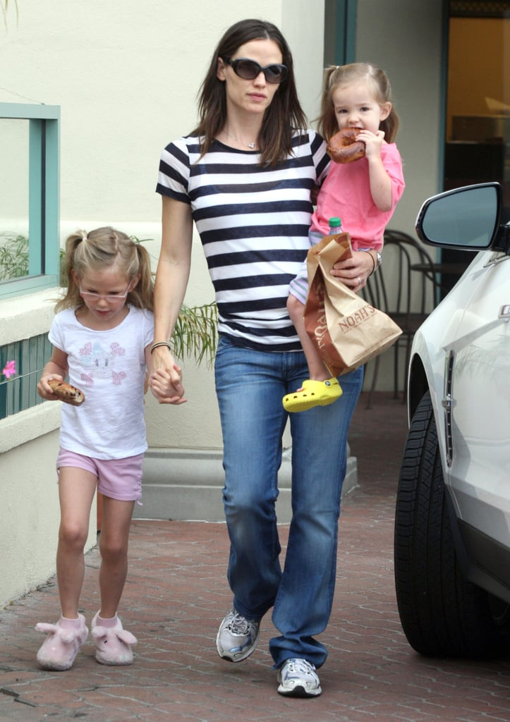 Jennifer Garner carried her youngest, Seraphina, and held her older daughter Violet's hand Saturday after picking up breakfast at a Noah's Bagels in LA. The Garner-Affleck girls have been all about their family food runs over the last week, also hitting the Brentwood Country Mart and an ice cream parlor for after-school treats. Jennifer was without her girls yesterday, though, when she went for a hike with two girlfriends. Jennifer, Violet, and Seraphina had a couple days of good girl time, as dad Ben Affleck is currently in France. He was spotted Friday out shopping in Paris, though he may decide to take a quick detour south in order to join in on the fun at the Cannes Film Festival. Ben's director friend Terence Malick is by the Mediterranean, having just debuted his latest project Tree of Life, this morning with Brad Pitt.
