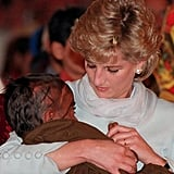 Diana cradled a sick child in her arms during her visit to Imran Khan's cancer hospital in Lahore, Pakistan, during April 1996.