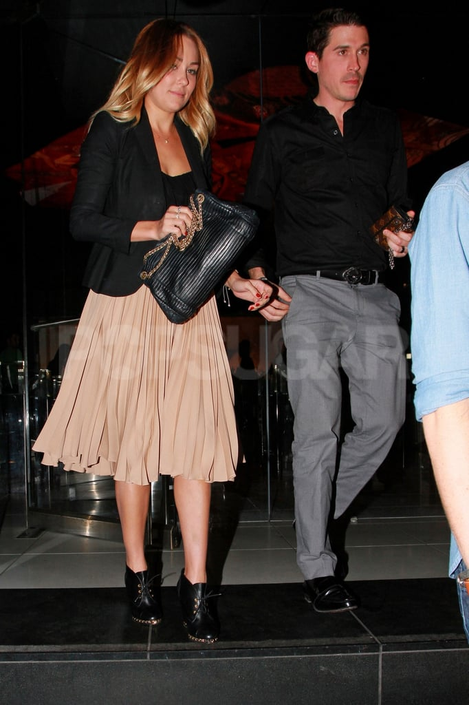 Lauren Conrad was accompanied by a male friend as she stepped out of Katsuya in LA yesterday following dinner with pals. It was LC's latest evening out after also recently partying at Beacher's Madhouse, where she reportedly ran into her ex, Derek Hough. LC and Derek apparently shared a few friendly words, though it didn't look like the duo were headed for reconciliation. The couple split in November and LC's been busy with family, fashion, and philanthropy since. Over the holidays, she treated teens from the LA Children's Hospital to a shopping spree at Kohl's before heading out of town for the break. LC was back in the spotlight for New Year's Eve, which she celebrated in Las Vegas with Stephanie Pratt.