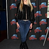 At a Planet Hollywood appearance in New York, the actress wore a black leather jacket with tough motorcycle boots but made the look girlie via a gold tassel necklace.       Leather Jackets by BB DakotaBoots by Gentle Souls