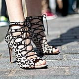 This showgoer brought her footwear A-game in Zara leopard-print lace-ups.