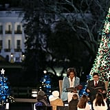Michelle Obama sat near the Christmas tree.