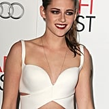 She was all smiles on the red carpet, showing off her sexier side with this cutout bustier-style top.