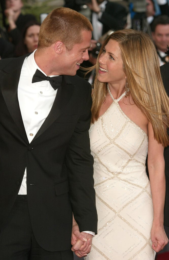 Then-couple Brad Pitt and Jennifer Aniston beamed on the red carpet at the premiere of Troy in 2004.