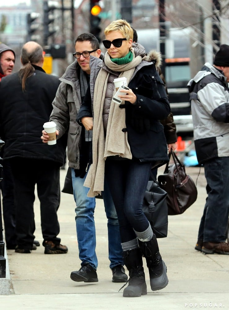 Charlize Theron kept warm in a jacket and scarf in Boston.