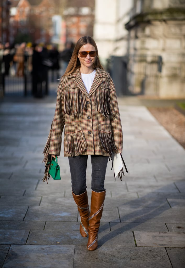 Dress up classic jeans with a fringed jacket